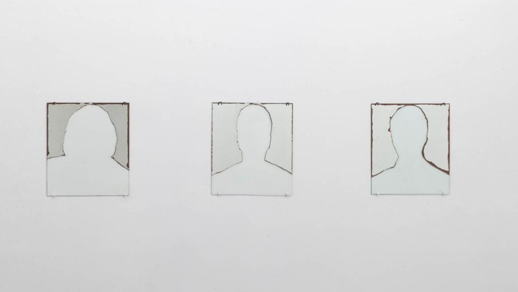 Mancanza di riflessione (original title: Non siamo che immagini negli occhi degli altri), 1994, three partially abraded mirrors, 40 x 40 cm each, ph. Giorgio Benni