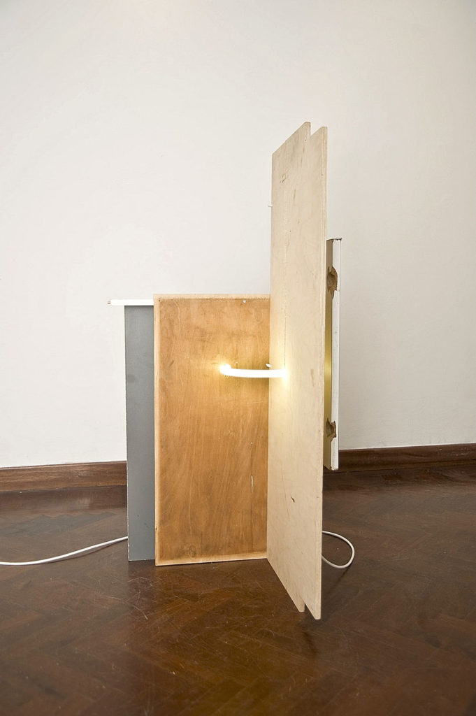 Untitled 13, 2010, fluorescent bulb, wood, electric cable, cm 112x58x54