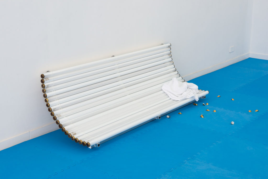 Golden Brown Texture Like Sun, 2017, used sun tanning bulbs, aluminium, towel, 53 x 178 x 56 cm, ph. Giorgio Benni