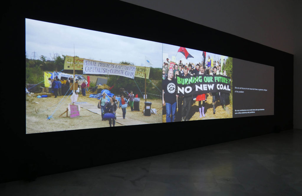 "Oliver Ressler, ""For A Completely Different Climate"", 3-channel slide installation with sound, 2008 (Installation view: ""We will beg for nothing, we will ask for nothing. We will take, we will occupy"", Centro Andaluz de Arte Contemporaneo – CAAC, Seville, 2015; photo: O. Ressler)"