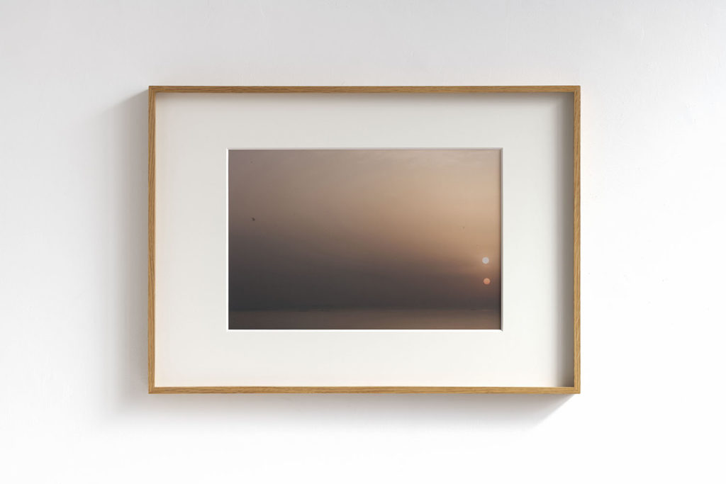 I've just seen two suns on the horizon, I'm feeling comfortable anyway, 2019, photographic print on cotton paper, 50x70 cm (framed). Photo: Giorgio Benni