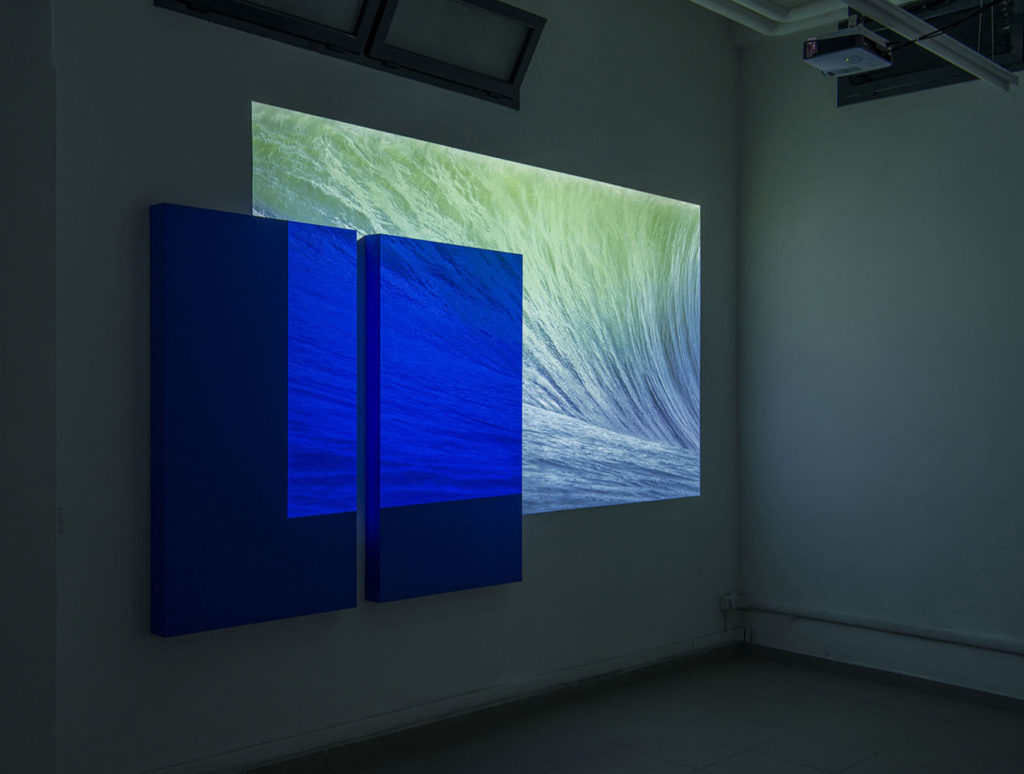 I've caught Derek Jarman and Yves Klein looking at my desktop wallpaper, 2015, Rosco chroma key blue paint on 2 canvas (90x160 cm each), projection, size variable. Photo: Giorgio Benni