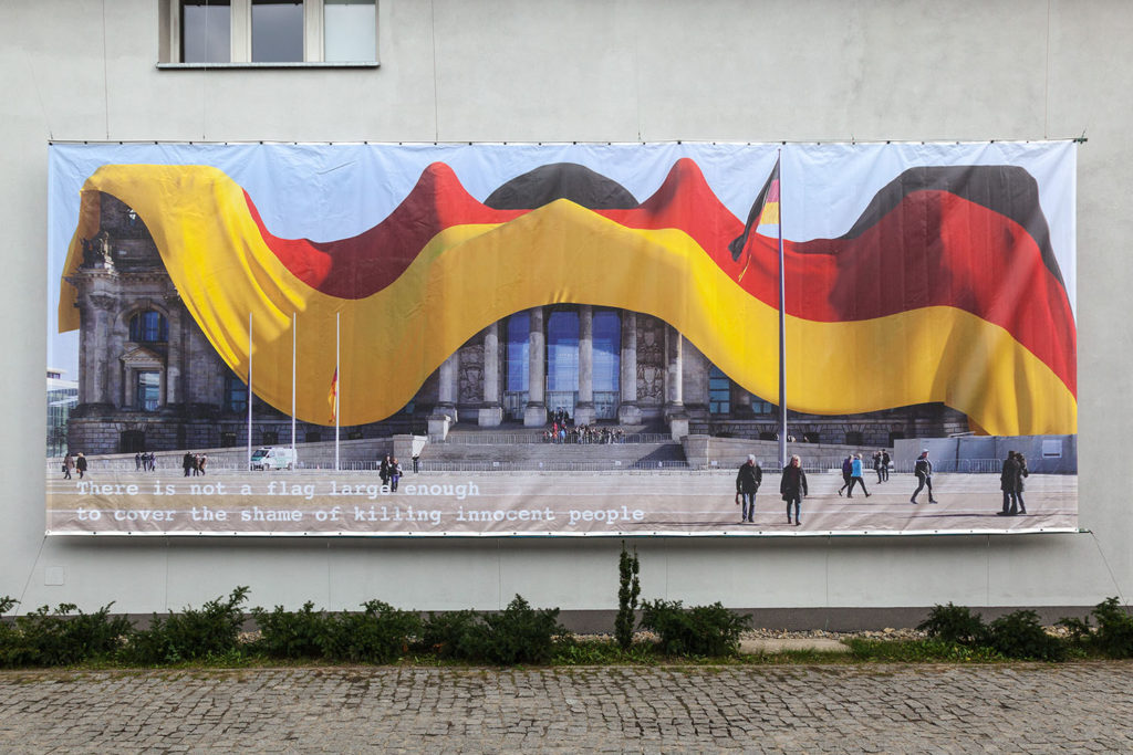 "Oliver Ressler, ""There is not a flag"", banner, 900 x 340 cm, 2015  (Installation view: ""Utopian Pulse – Flares in the Darkroom"", MOCAK – Museum of Contemporary Art, Krakow; photo: Rafał Sosin)"