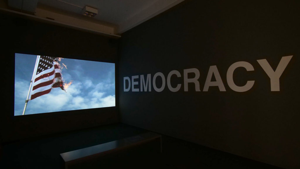 "Oliver Ressler, ""What Is Democracy?"", 8-channel video installation, 2009 (Installation view: ""Antidoron – The EMST Collection"", Documenta 14, Kassel, 2017; photo: O. Ressler)"