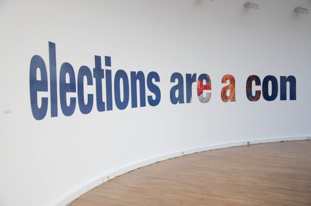 "Oliver Ressler, ""Elections are a Con"", wall text, 2011 (Installation view: Galerija PM, Zagreb; photo: Elvis Krstulović)"